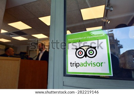 JERUSALEM - MAR 24 2015:Trip advisor sticker on restaurant window in Jerusalem, Israel.TripAdvisor is the most trusted travel website provide over 200M  traveler reviews on destinations and business. - stock photo