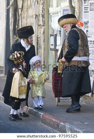 JERUSALEM - MAR. 09 : Ultra Orthodox man give presents to a children during Purim in Mea Shearim Jerusalem on Mar. 09 2012 , Giving presents to children is a tradition of Purim