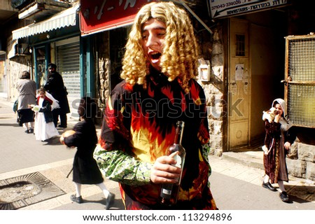 JERUSALEM - MARCH 15: Ultra-orthodox Jewish man dressed as a woman on the Jewish holiday Purim on March 15 2006 in Mea Shearim in Jerusalem, Israel.