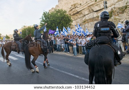 JERUSALEM - MAY 20 : Israeli men march in east Jerusalem  during Jerusalem day on May 20 2012 , Jerusalem day marks the anniversary of the city's reunification in 1967 after 19 years of division - stock photo