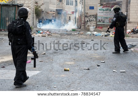 JERUSALEM - MAY 15: Israeli police fire tear gas at Palestinian youth in the Al-Issawiya neighborhood of East Jerusalem during clashes on Nakba Day, May 15, 2011.
