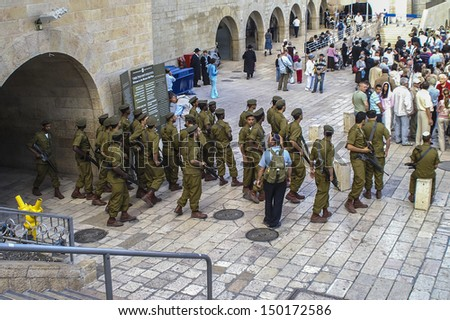 JERUSALEM - MAY 1: Jews gather to pray at the Wailing Wall, the last remaining wall of Herod's Temple and a sacred site for Jews and Christians on May 1, 2011 in Jerusalem, Israel. - stock photo