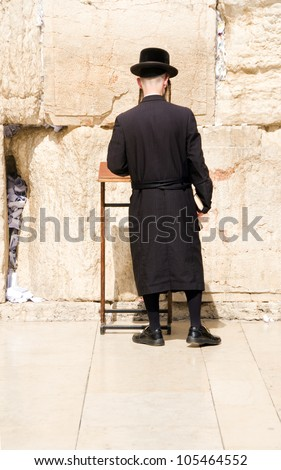 JERUSALEM-MAY 28: Unidentified  Hasidic  Jewish man  praying at The Western Wall Jerusalem  on Shavout May 28, 2012.  Shavuot  is the end of the seven-week period between Passover and Shavuot. - stock photo