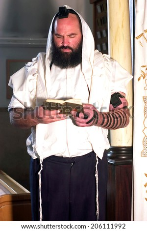 JERUSALEM - NOV 20 2005:Orthodox Jewish man prays in a synagogue. As of 2001, Orthodox Jews and Jews affiliated with an Orthodox synagogue accounted for approximately 25% of Israeli Jews (1,500,000) - stock photo