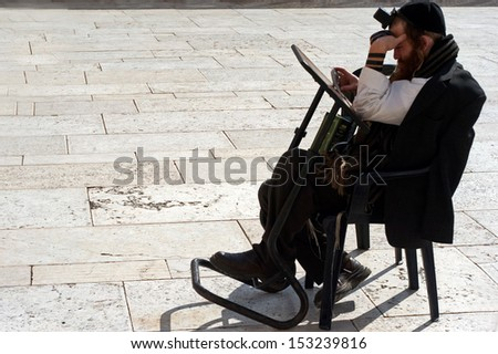 JERUSALEM - OCT 08 :Jewish man pray at the Western Wall during the High Holy Days on Oct 08 2005.During the 10 days before Yom Kippur Holiday Jewish people practice Teshuvah - engaging in repentance. - stock photo