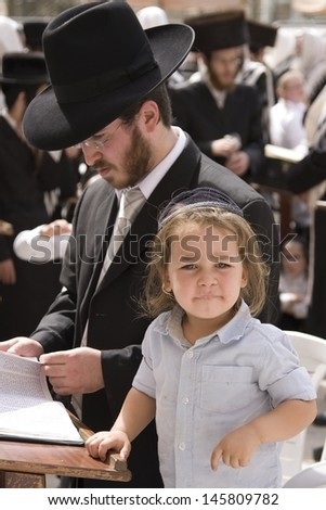 JERUSALEM -OCT 02: Unidentified boy at the Western Wall during Jewish holiday of Sukkot October 02, 2012 in Jerusalem, Israel. - stock photo