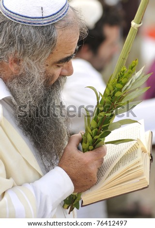 JERUSALEM - OCTOBER 09: An unidentified Jewish man in prayer at the Olive Mountain during Jewish holiday of Sukkot on October 09, 2009 in Jerusalem, Israel. - stock photo