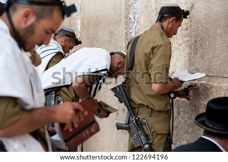 JERUSALEM - OCTOBER 21: Israeli soldiers pray at Jerusalem's Western Wall, Oct. 21, 2012. Israel's annexation of East Jerusalem in 1967, including the Old City, was never internationally recognized. - stock photo