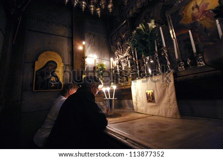 JERUSALEM - OCTOBER 01: Pilgrims pray at the tomb of Jesus in the Church of the Holy Sepulchre, in Jerusalem, Israel on Oct. 1, 2006. It is the traditional site of the crucifixion, burial, and resurrection of Jesus.