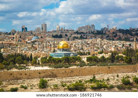 Jerusalem of Gold under cloudy sky - old town view from Mount of Olives - stock photo