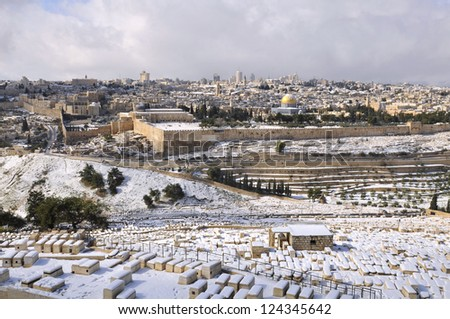 Jerusalem Old City under snow, view from the Mountain of Olives and Old Jewish cemetery - stock photo