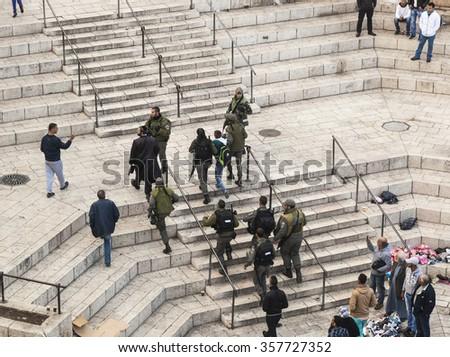 JERUSALEM OLD TOWN, ISRAEL - NOVEMBER 1, 2014: Unidentified Israeli soldiers apprehend a man near Damascus gate. - stock photo