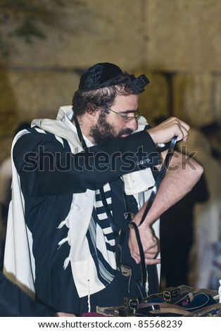 """JERUSALEM - SEP 26 : Jewish man prays during the penitential prayers the """"Selichot"""" , held on September 26 2011 in the """"Wailing wall""""  in  Jerusalem , Israel - stock photo"""
