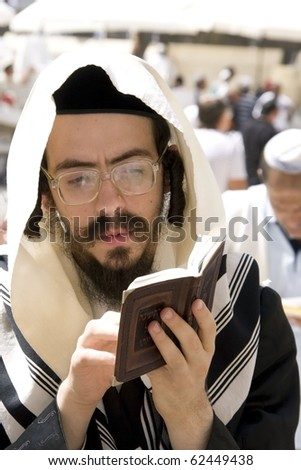 JERUSALEM - SEPT 27: Jews in prayer at the Western Wall during Jewish holiday of Sukkot September 27, 2010 in Jerusalem, Israel.
