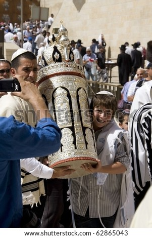 JERUSALEM -SEPT 27: Jews in prayer at the Western Wall during Jewish holiday of Sukkot September 27, 2010 in Jerusalem, Israel. - stock photo