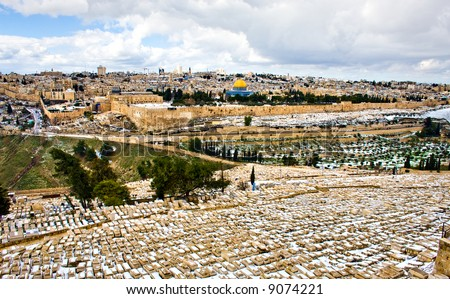 Jerusalem under rare snow, panorama view from old cemetery - stock photo