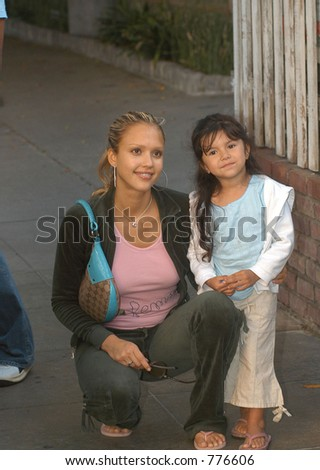 Jessica Alba and her boyfreind have a late lunch in Beverly Hills but find time to pose with her young fan, Los Angeles, Ca, 05/01/04 - stock photo