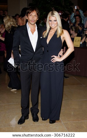 Jessica Simpson and Ken Paves at the Operation Smile's 8th Annual Smile Gala held at the Beverly Hilton Hotel in Beverly Hills, USA on October 2, 2009. - stock photo