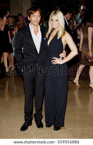 Jessica Simpson and Ken Paves at the Operation Smile's 8th Annual Smile Gala held at the Beverly Hilton Hotel in Beverly Hill, California, United States on October 2, 2009.   - stock photo
