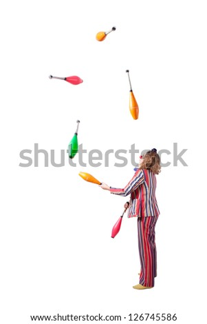 jester juggling with skittles - stock photo
