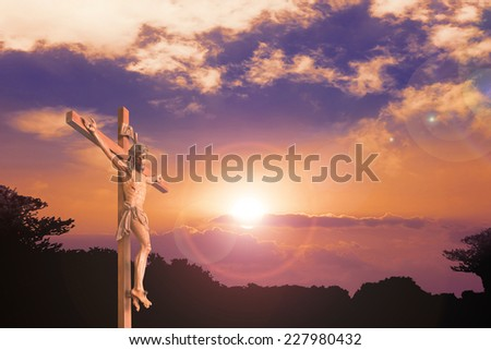 Jesus and the cross over sunset background. - stock photo