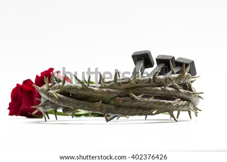 Jesus Christ crown of thorns, nails and two roses on a white background. - stock photo