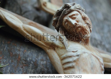 Jesus Christ crucified (an ancient wooden sculpture) (details) - stock photo