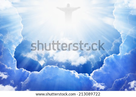 Jesus Christ in blue sky with clouds, bright light from heaven, resurrection concept, easter background - stock photo