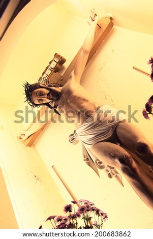 Jesus Christ on the cross in Macao church - stock photo