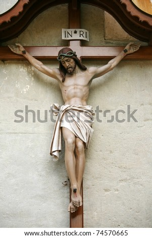 Jesus Christ on the Cross on the wall - stock photo
