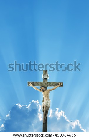Jesus Christ on the cross over bright sky background vertical image - stock photo
