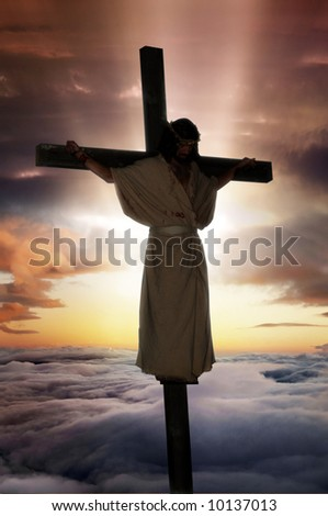 Jesus Christ on the cross with sunburst & clouds behind him. - stock photo
