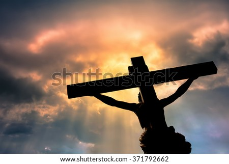 Jesus Christ Son of God over dramatic sky background religion and spirituality concept - stock photo