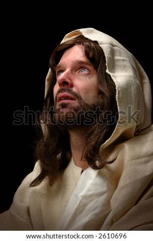 Jesus cried. Represented by portrait of Jesus looking into heaven and shedding a tear. - stock photo