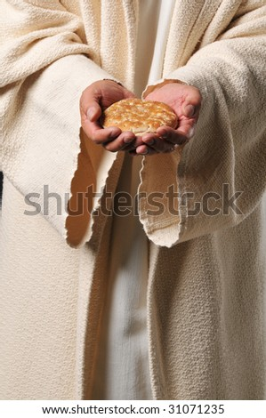 Jesus holding a bread as a symbol of bread of life - stock photo
