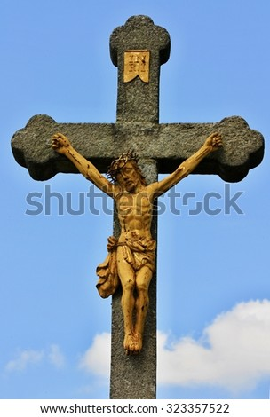 Jesus on the cross against blue sky background - stock photo