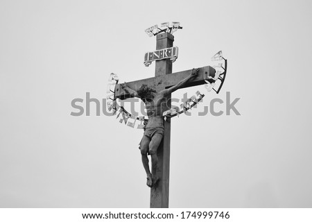 Jesus on the cross at Charles bridge, Prague, Czech republic. Black and white. - stock photo