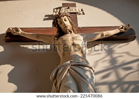 Jesus on the cross in vestibule of church in Vienna  - stock photo