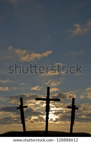 Jesus on the Cross with sunset in the background - stock photo