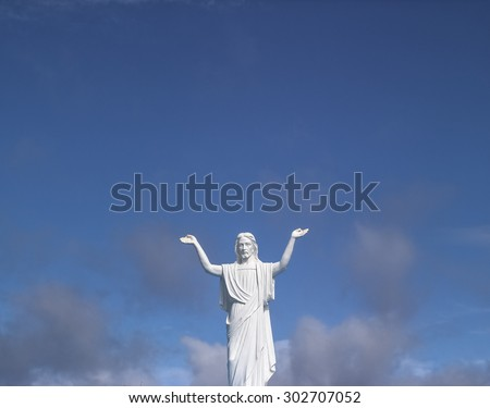 Jesus statue blesses the world - stock photo