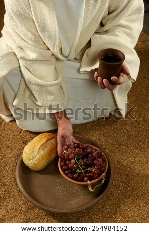 Jesus with bread wine and grapes on a vertical format - stock photo