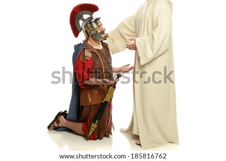 Jesus with his hand on a Roman soldier isolated on a white background - stock photo