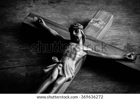 Jesus with the cross on black and white ,Faith belief and hope concept - stock photo