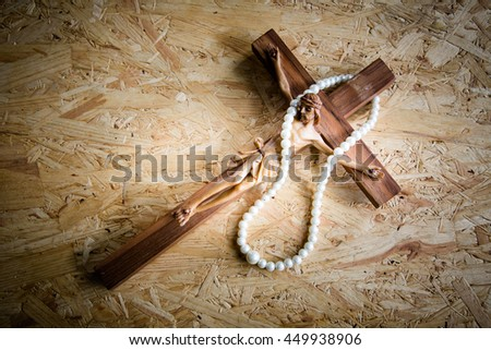 Jesus with the cross on wooden background,Faith belief and hope concept - stock photo