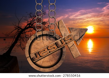 Jesus Wooden Symbol with Cross at the Sunset. Wooden symbol with cross and arrow upward and text Jesus. Hanging from a chain at a beautiful sunset over the lake with clouds - stock photo