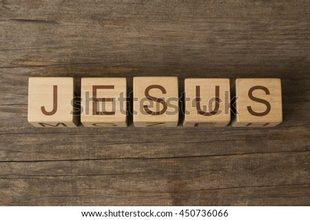 JESUS word on wooden cubes - stock photo