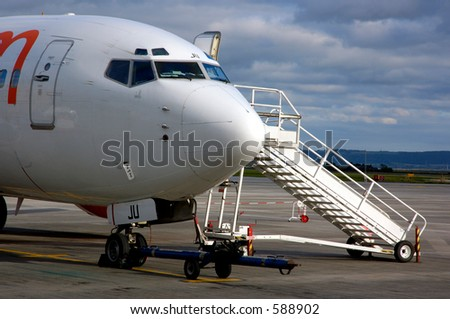 Jet Aircraft Getting Ready To Load Passengers - stock photo