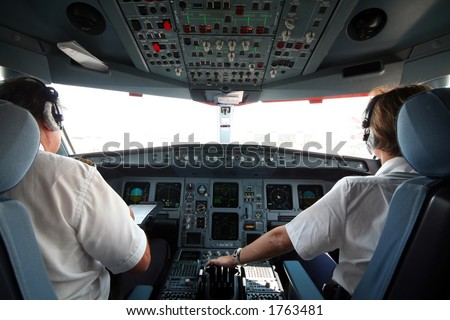 Jet airplane cockpit with two pilots crewmembers