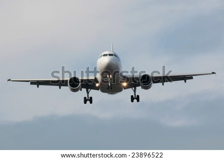 Jet airplane is approaching runway - stock photo