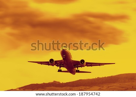 Jet airplane takeoff at sunset time - stock photo